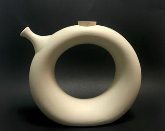 Hartstone modernist wine carafe cooler, ring donut shape with cork, off white bisque, signed