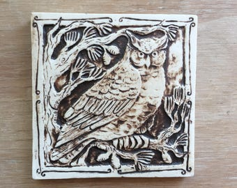 Handmade ceramic owl tile in dark brown wash for wall hanging or installation