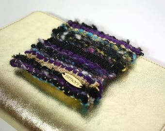 hand-woven textural clutch with leather gold