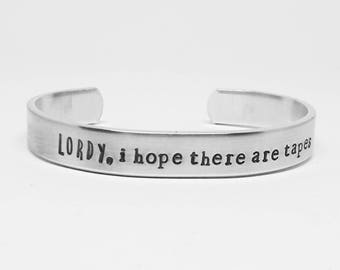 Lordy, I hope there are tapes. Hand stamped aluminum Comey quote cuff by fandomonium