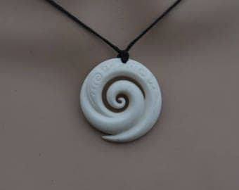Maori Koru ~ Ocean waves. Hand carved cow bone pendant