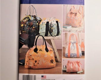 Assorted Carryall Bags, Backpack, Totes, and Cosmetic Bag, Five different styles and sizes, New Simplicity Sewing Pattern 8037 - 26 Pieces