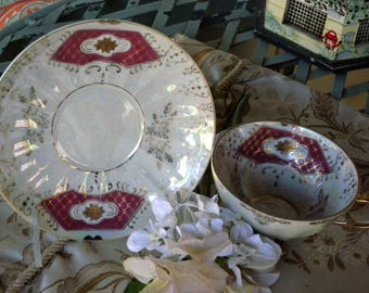 Footed Tea Cup and Saucer in a Fluted Cup with Burgundy and white and Gold Stars iridescent and Gold Trims Throughout