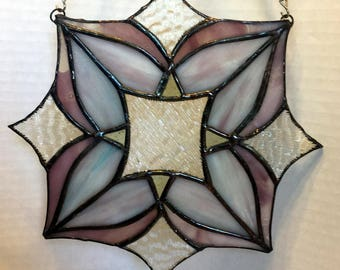 Abstract floral stained glass window panel in pale purples, blues, and clear colors