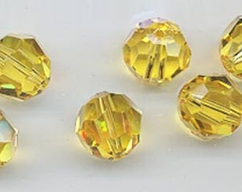 Twelve Swarovski crystals: art 5000 - 10 mm - discontinued color light topaz ABcantaloupe AB