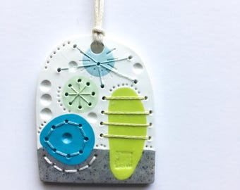 WEIRDLINGS polymer clay pendant green blue grey granite with stitching detail