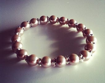 Bracelet beads beige and small silver flowers