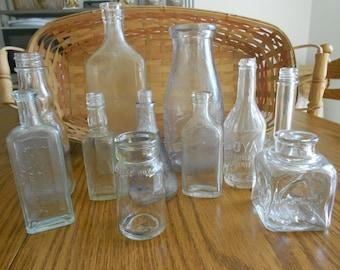 Eleven Vintage Apothecary bottles ,medicine bottles, perfume bottle and ink well milk bottle