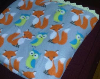 "Owl and Fox 52""x62"" fleece blanket crochet edging. Polyester and acrylic. Machine wash cold gentle cycle tumble dry."