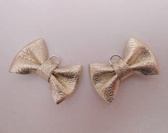 Mini 2 x 3 cm champagne leather knot