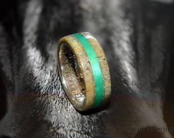 Silver half dollar coin ring with deer antler and emerald inlay