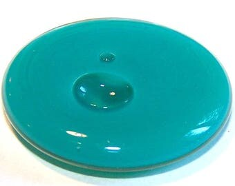A globe round 34 mm turquoise OPAQUE liquid filled glass