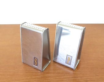 Stainless steel salt and pepper shakers, tall triangular shape