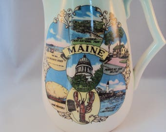 Maine souvenir pitcher, c. 1960's, scenes of Maine, ceramic