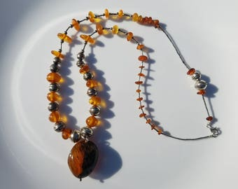 One of a kind asymetrical amber and vintage silver beads necklace