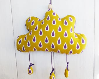CLOUD mustard and purple fabric and hanging rain drops.