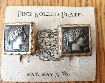 Antique rolled gold plate cuff links with Roman face