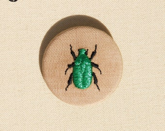Small embroidered green beetle brooch