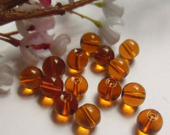 set of 8 round brown glass beads
