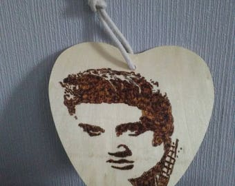 Elvis image burned on birch heart.