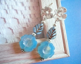 Silver flower and light blue glass flower and leaf earrings