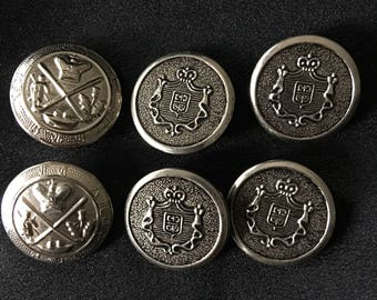 6 metal shank buttons Coat of arms Family crest 4 Pewter finished  2 Silver tone metal Slightly domed  Sewing Collectibles about 1 inch