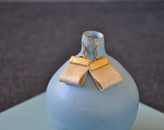 Earrings in gold glitter fabric