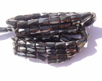 Magnetic Hematite: 7 beads faceted 8 mm long x 5 mm in diameter