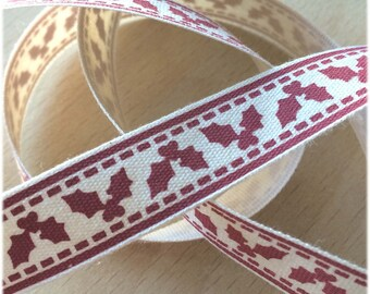 "decorative Ribbon: ""reddish brown Holly"" on an ecru background"
