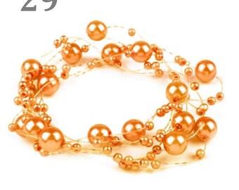 Orange wreath adorned with pearls 130 cm