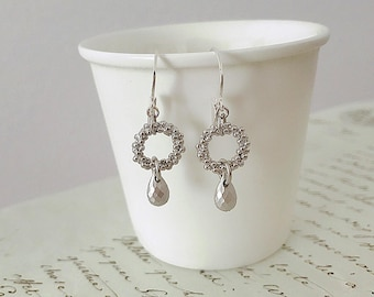 Silver ring textured with matte faceted drops Silver earrings