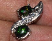 50% Off A Classic 5 x 7 mm  Natural Ethiopian  Black Opal Pendant with a stunning set in sterling silver Length is 2 Cm.