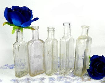 Mid Century Clear Glass Bottle Grouping for a Sunny Window