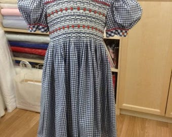 A striking Hand Smocked dress in navy gingham