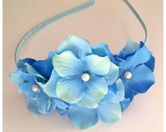 Blue fascintor with flowers, lightblue headdress