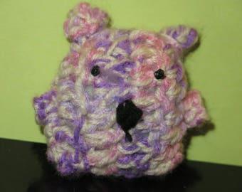 Multi-colored crocheted bear