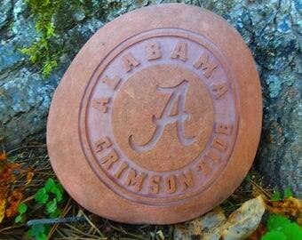 Alabama Crimson Tide logo hand sandcarved into red river stone
