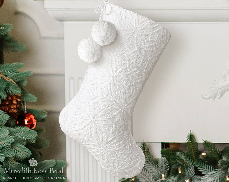 White Christmas Stockings: Christmas stocking by color are one way to shop! You can find the ever common reds and greens for the holiday but don't forget some more unique options. You can find the ever common reds and greens for the holiday but don't forget some more unique options.