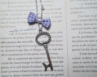 Silver large key + purple bow necklace