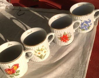 Set of 4 Chechloslovakia calendar birthday porcelain mugs poinsettia violet rose and other