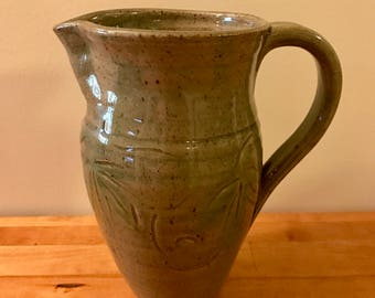 Tall Carved Pitcher
