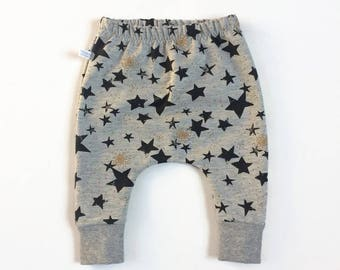 Grey baby infant harem pants with black and gold stars. Slim fit harem pants with cuffs. Gray sweat fabric.  Infant sweat pants