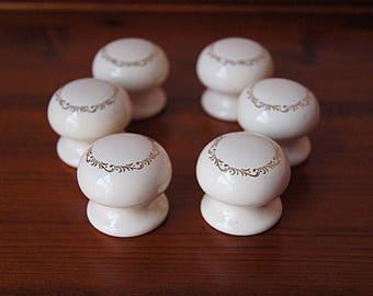 6 Porcelain drawer knobs, vintage  ceramic drawer pulls with gold ornament.