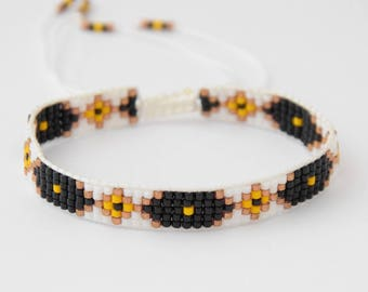 Black, white and yellow woven bracelet