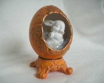 1 decorative egg, orange yellow