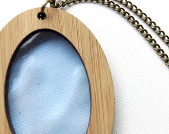 Transparent Blue Glass in Wooden Oval Pendant on chain