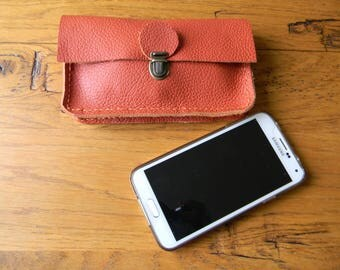 Orange clutch as wearable belt