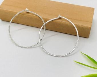 Hammered sterling silver round hoop earring