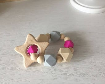 Natuel untreated wood and non toxic BPA free silicone teething ring or bracelet.