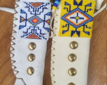 Authentic hand made beaded knife sheath by Doug Fast Horse